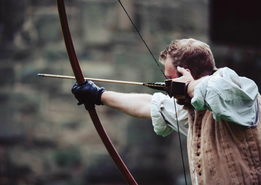 archer shooting an arrow